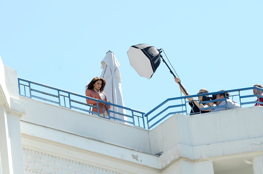 Eva Longoria posed for a L'Oréal photo shoot on the top of a hotel in Cannes.