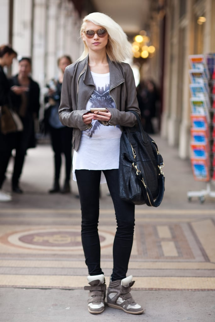 Street-cool and color-coordinated, from her soft leather jacket to her wedged sneakers. Source: Le 21ème | Adam Katz Sinding