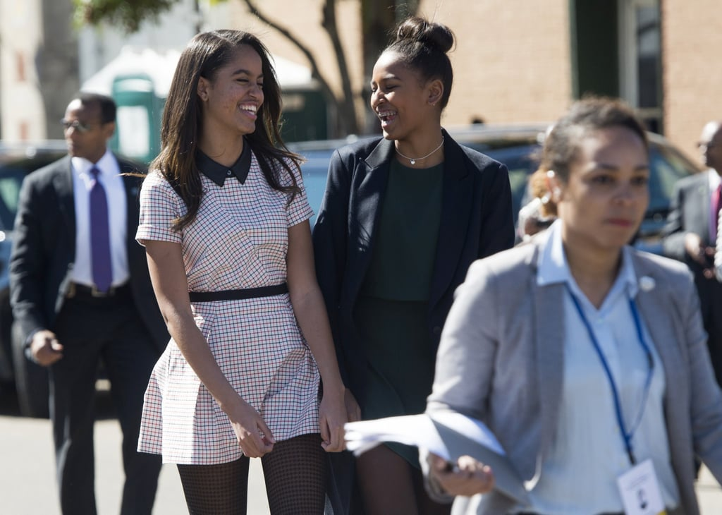Malia and Sasha shared a laugh when they stepped out with their parents in Alabama in March 2015.