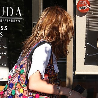 Guess Who Is Carrying a Wildly Colorful Purse?