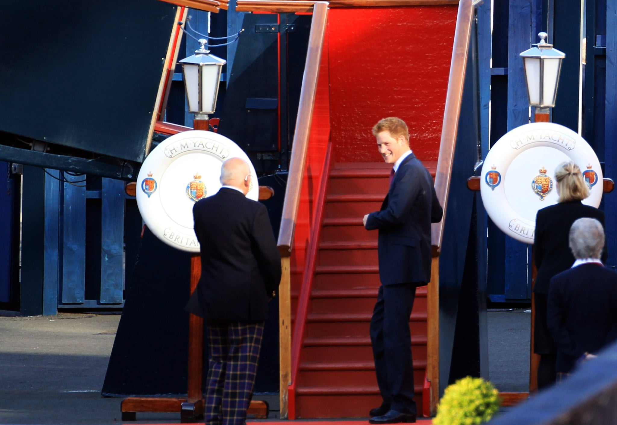 Prince Harry on the Royal Yacht Britannia for Zara Phillips's wedding.