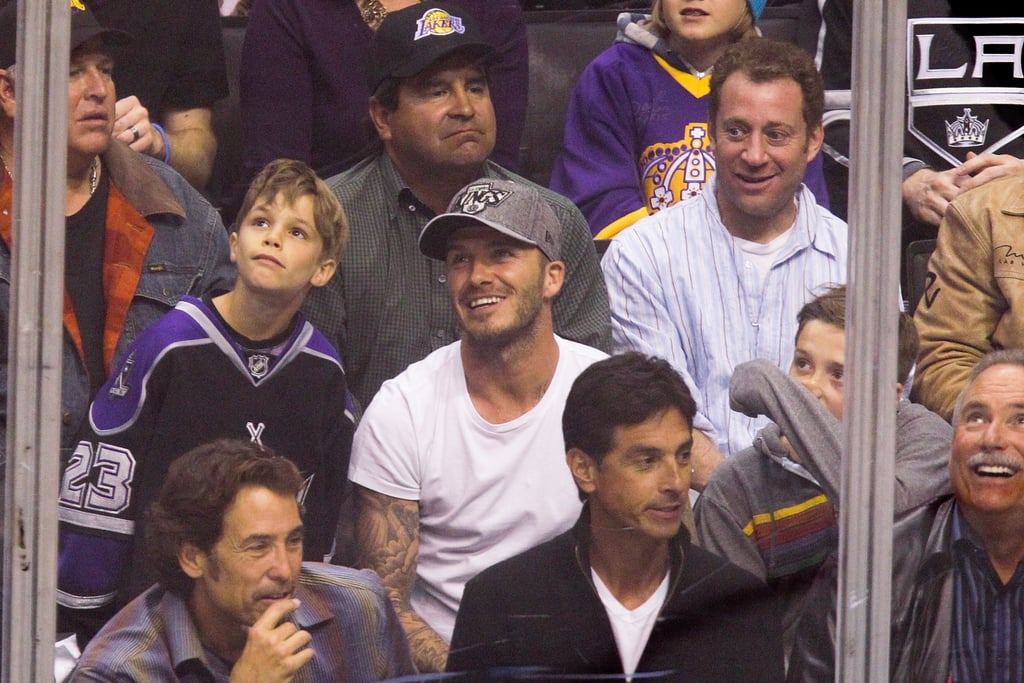 David Beckham had a laugh with his sons at a playoff hockey game at the Staples Center in LA.