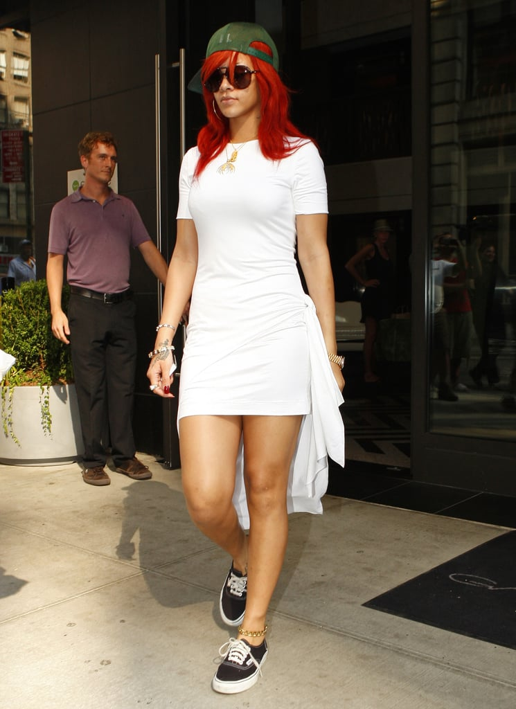 The singer funked up her angelic Cushnie Et Ochs t-shirt dress with a side-turned army-green baseball cap, black Vans, and oversize aviators while leaving her NYC hotel in July 2011.