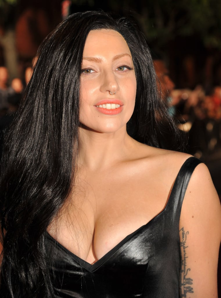 The theme was all black for Lady Gaga at the 2013 VMAs. She wore a long, jet-black wig to accompany her leather dress, adding a pop of color with a melon orange lipstick.