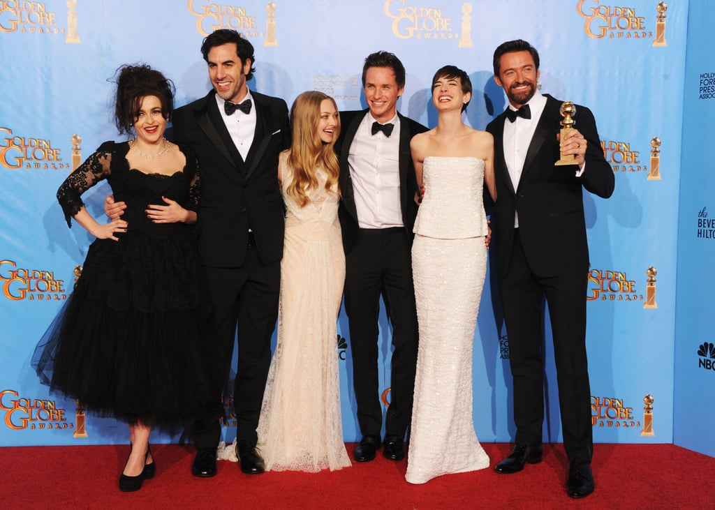 The cast of Les Mis — from left, Helena Bonham Carter, Sacha Baron Cohen, Amanda Seyfried, Eddie Redmayne, Anne Hathaway and Hugh Jackman — celebrated their Golden Globe wins on January 13.