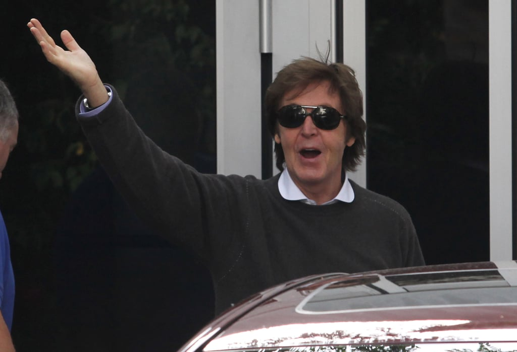Paul McCartney waves to fans one day after his wedding.