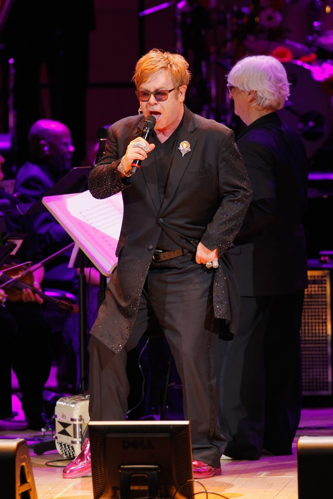 Elton John danced at the Revlon Concert for the Rainforest Fund at Carnegie Hall in NYC.