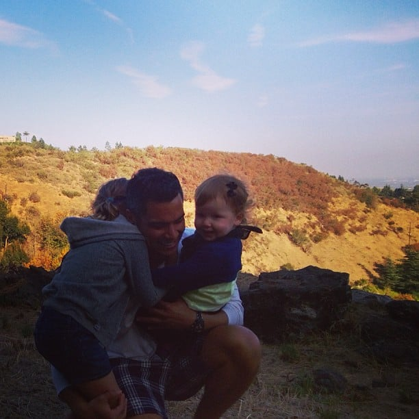 Cash Warren was greeted by big hugs from his girls upon his return from Asia. Source: Instagram user jessicaalba