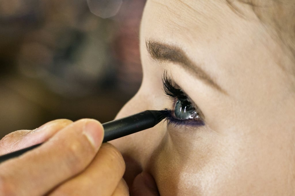 """To create a plum smoky eye, waterline of the bottom lashes at the root and just under the lashes with a deep violet liner — Jennings used MAC Pro's Longwear Eyeliner in Snow Shadow ($20). """"You want it to show up and be smoky,"""" Jennings says. """"Make sure there are no spaces or gaps so you don't see any light spots on the eye."""""""