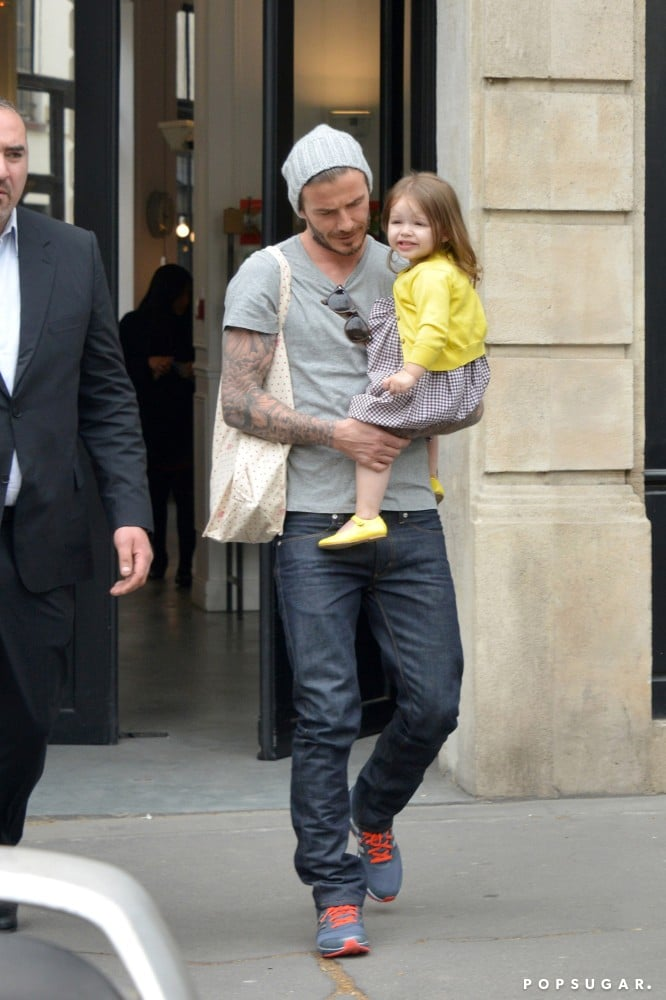 David Beckham carried Harper for an outing in Paris.
