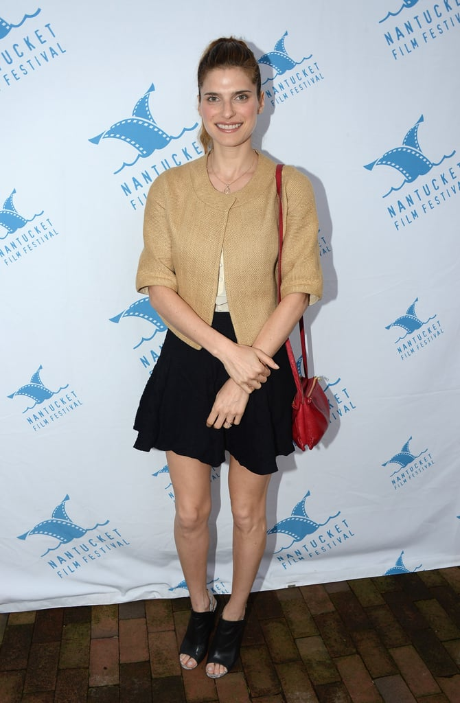 Lake Bell was fashion-forward in a black miniskirt, black peep-toe booties, and a red bag in Nantucket, MA.