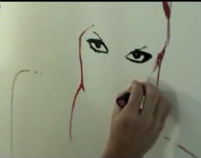 Gwen Stefani Gets Painted... With Lipstick