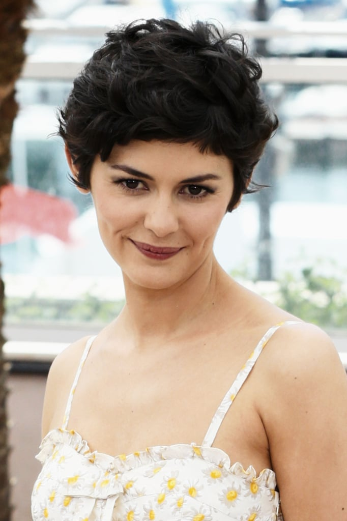 French actress Audrey Tautou styled her iconic pixie in piecey, textured curls. Bold brows and a mauve lip highlighted her glowing skin.