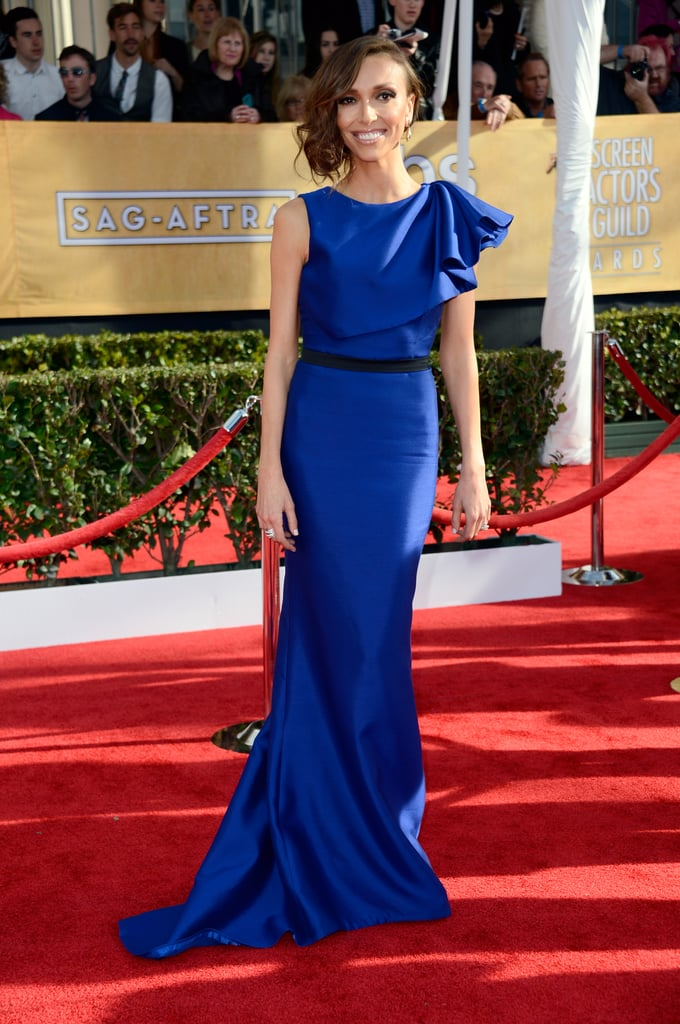 Giuliana Rancic stepped out in a cobalt blue ruffled-shouldered Max Azria Atelier that came complete with black belt detailing at the waistline.