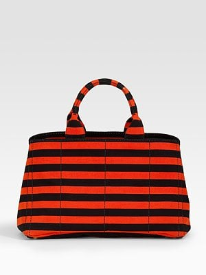 We love Prada's bold take on stripes this Spring. This orange and black version tote will make a standout statement with any ensemble.  Prada Striped Tote ($695)