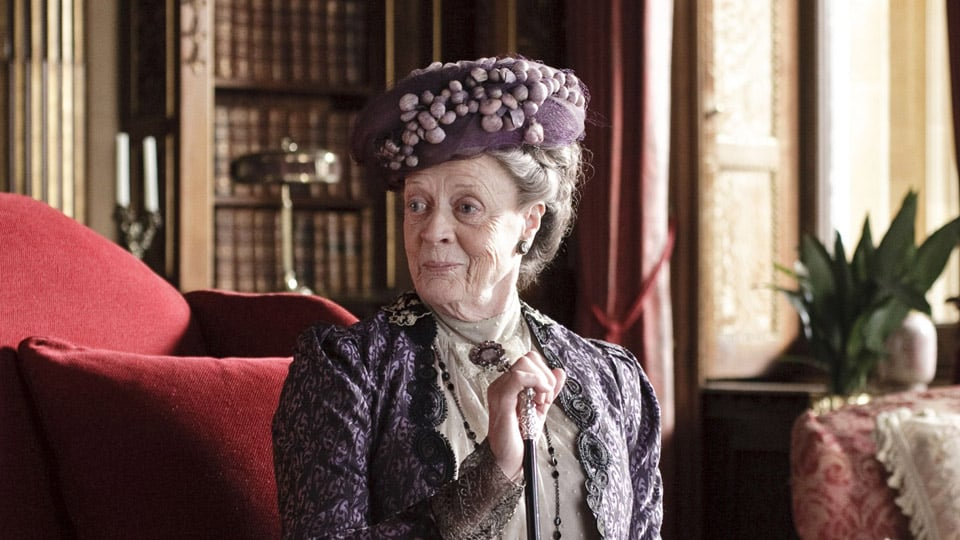Outstanding Supporting Actress in a Drama Series Maggie Smith truly has perfected the sophisticated but judgmental Dowager Countess during her tenure on Downton Abbey. Though at times steely and — dare I say — uppity, Smith provides a slight but visible tenderness when it comes to the Crawley family. It's the kind of depth that only Smith can provide, and she deserves a third Emmy for the role. Source: ITV