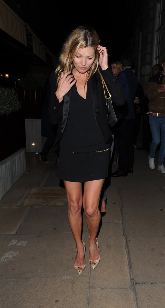Kate Moss paired a little black dress with a black tuxedo blazer by Saint Laurent and printed pumps during a night out in London.