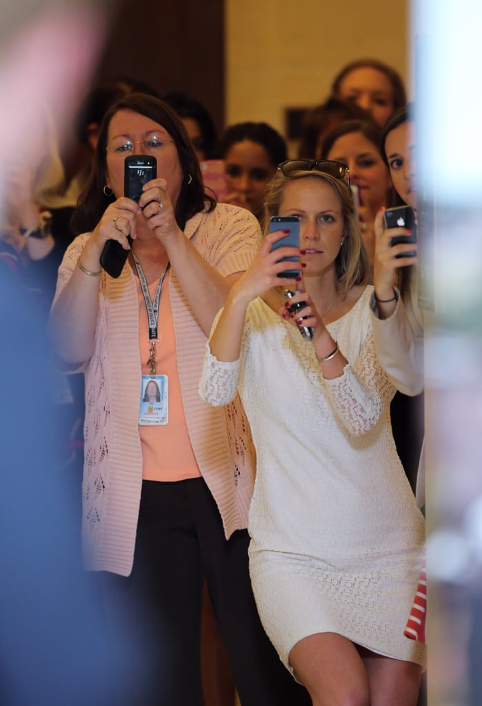 Smartphones came out when Prince Harry passed by during a stop in DC.