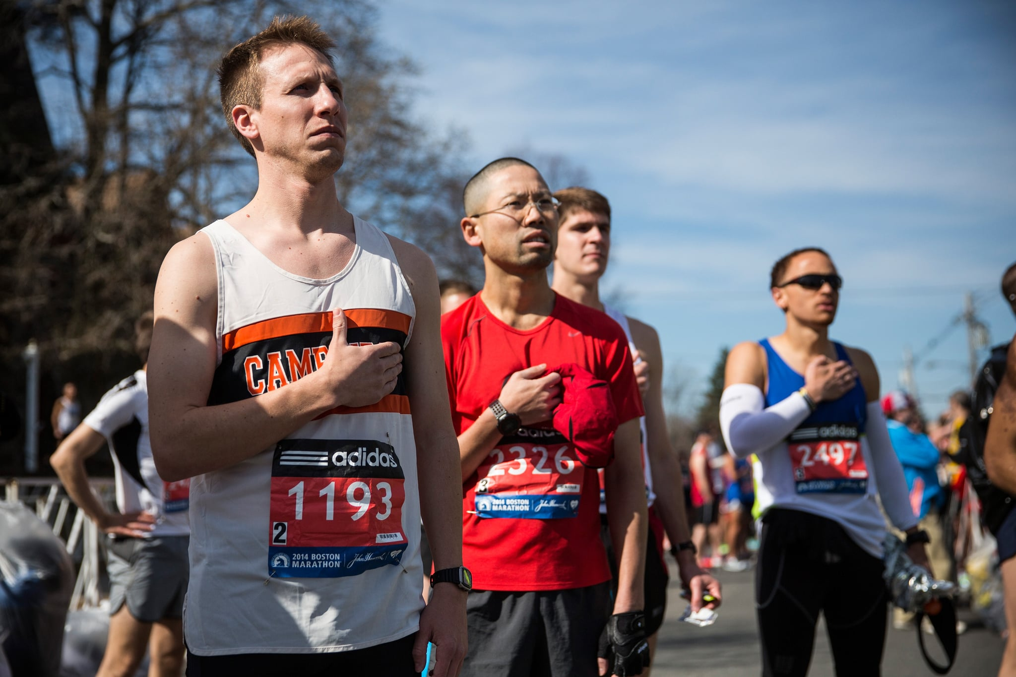 Runners placed their hands over their hearts for the national anthem.