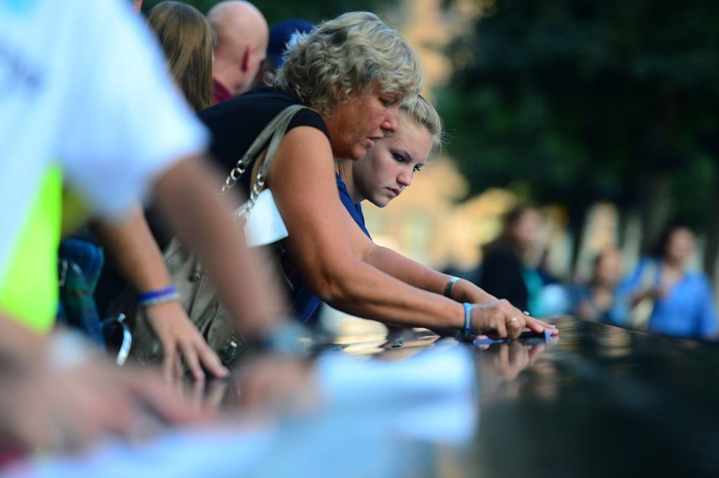 Gail Silke and her niece Erica traced the name of Gail's brother, Steven Bristoll, who worked as a police officer, at the 9/11 Memorial in NYC.
