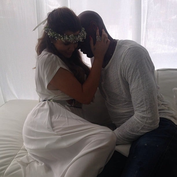 Khloé Kardashian shared a romantic moment with her husband, Lamar Odom, at Kim Kardashian's baby shower.  Source: Instagram user KhloeKardashian