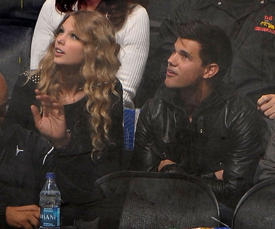 Photo Slide of Taylor Lautner And Taylor Swift at a Hockey Game in LA