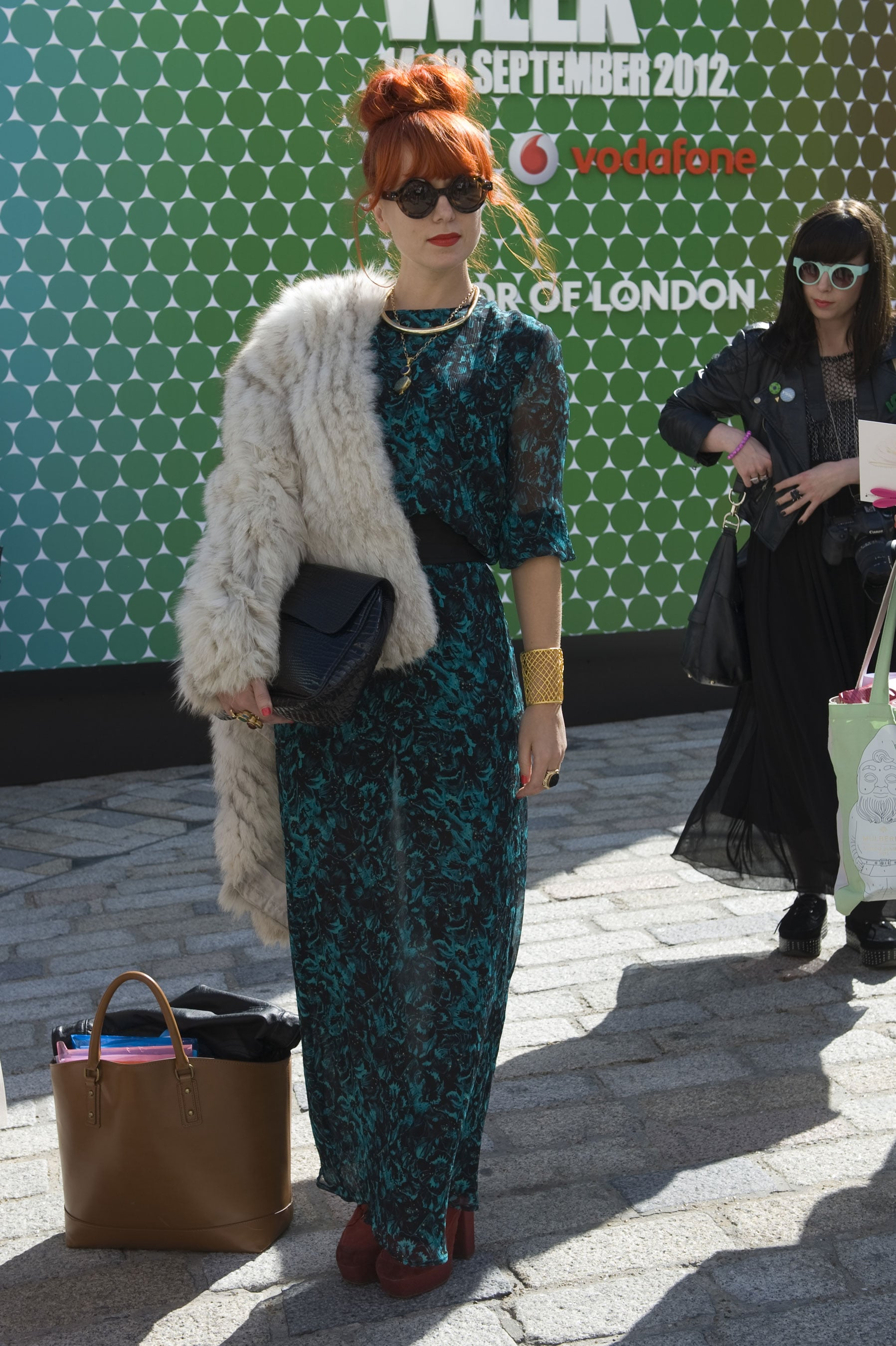 We can't decide what we love more: her printed jumpsuit or that insanely cool fur coat. Do you have a preference?