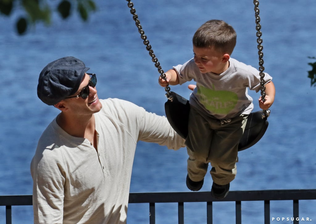 Tom Brady gave his son Ben a push on the swings in Boston on Sunday.