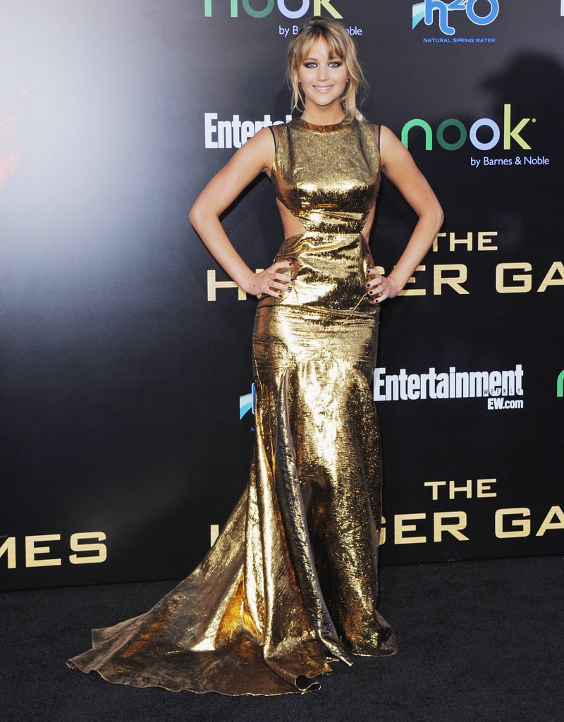At the LA premiere of The Hunger Games, Jennifer Lawrence made an appearance in knockout gold lamé cutout gown from Prabal Gurung's Fall 2012 collection.