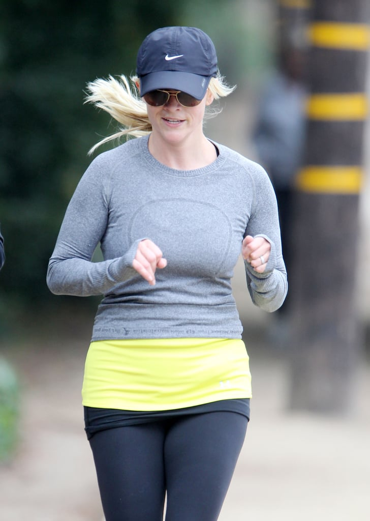 Reese Witherspoon running in a yellow top.