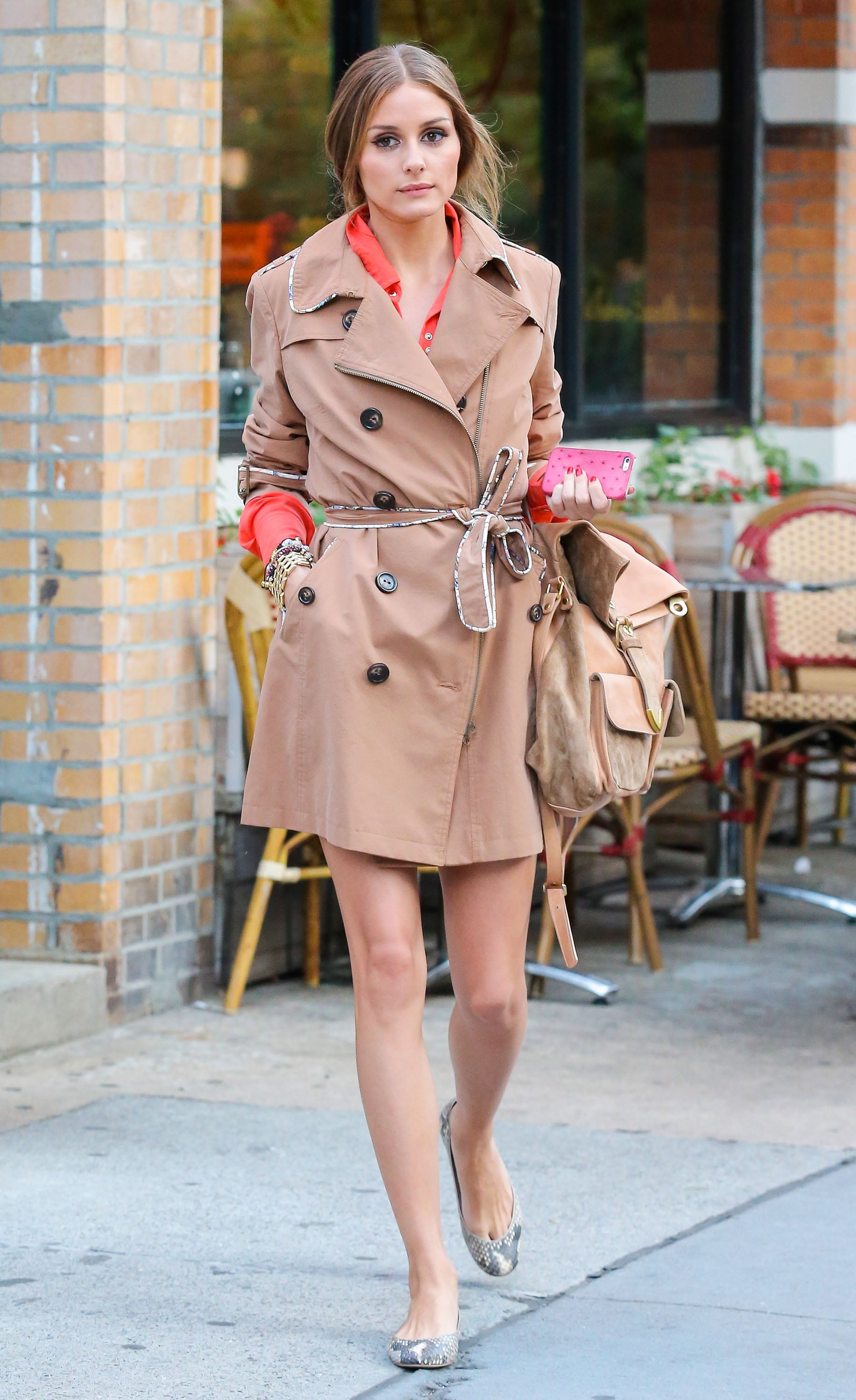 While out to lunch in NYC, Olivia Palermo layered up in a chic trench coat with cool piping then finished with snakeskin flats.