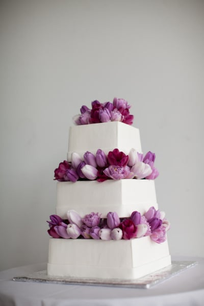 By arranging different shades of tulips to create a starburst effect, this cake reinvents the notion of flower-filled cake.  Photo by  The Popes via
