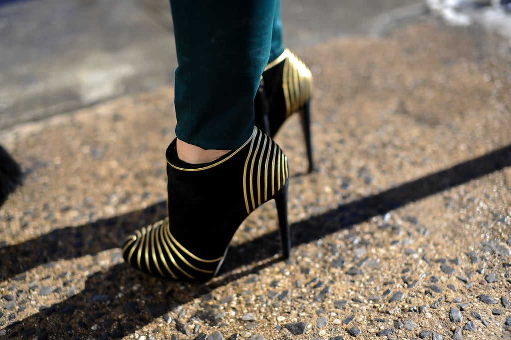 Gold-embellished ankle boots had all eyes on her footwear outside the Rebecca Taylor show.