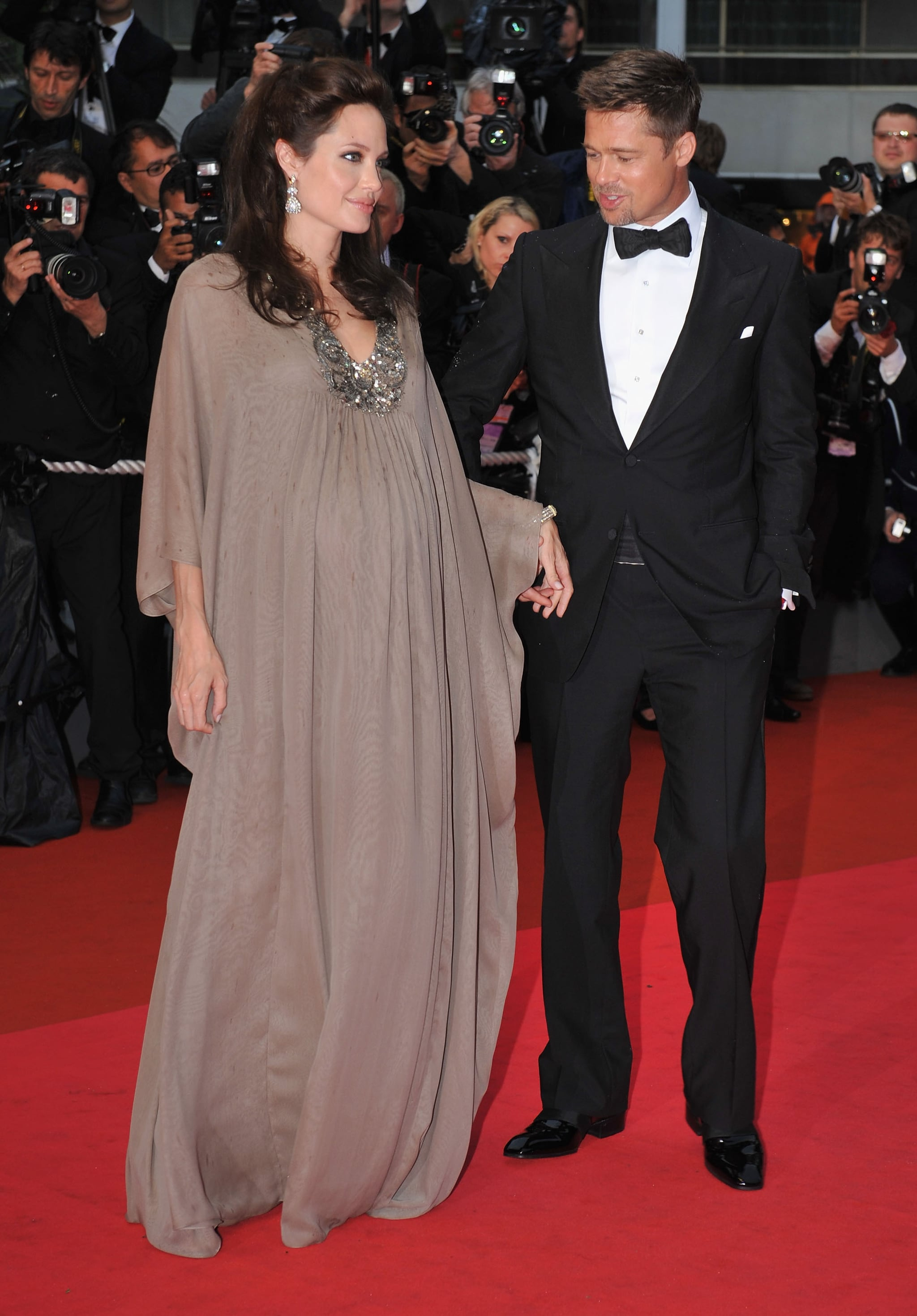 Brad Pitt smiled looking at Angelina Jolie's baby bump at the 2008 Cannes Film Festival screening of her drama Changeling.