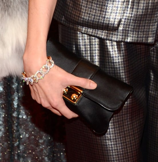 Sofia Coppola wore a diamond chain bracelet and carried a black clutch.