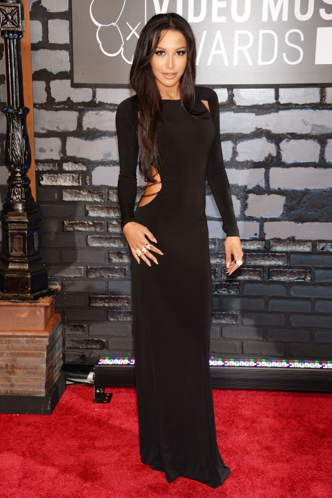 Naya Rivera stunned in a long black gown with a sexy side cutout, accessorized with jewels by Marina B.