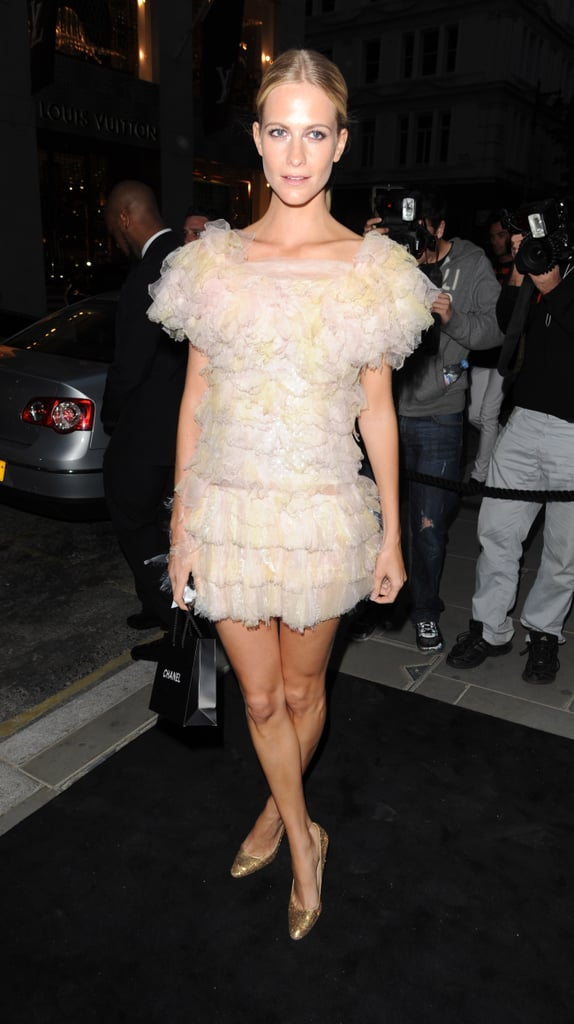 Poppy selected a frothy minidress — and finished once again with gold, glittering footwear.