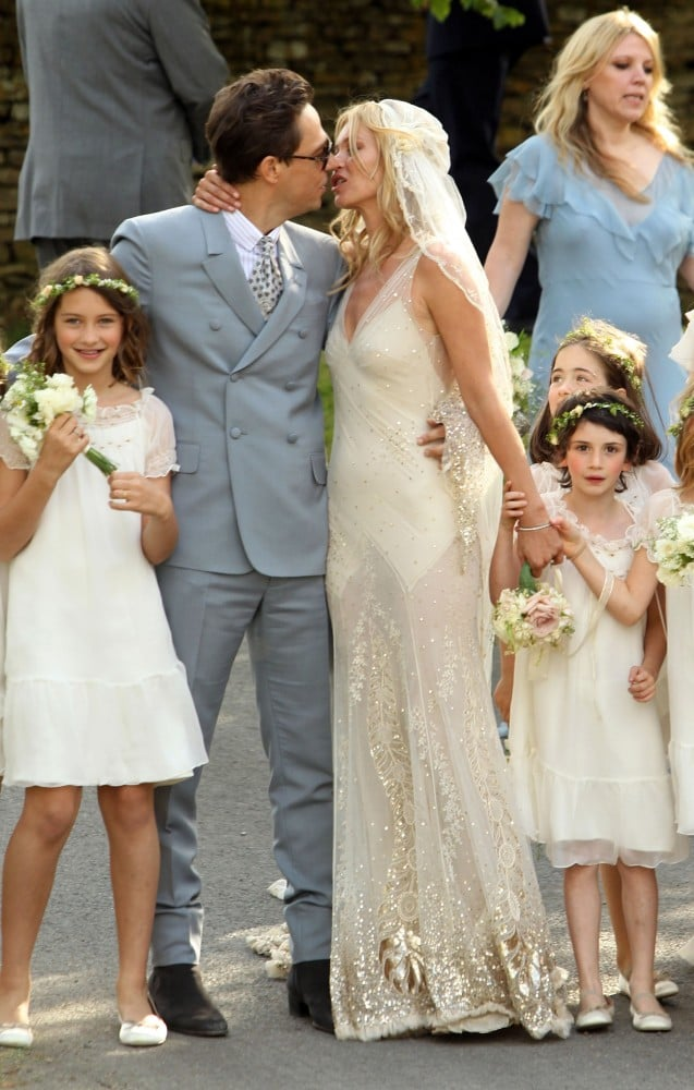Jamie Hince and Kate Moss, wearing John Galliano, posed for a kiss following their July 1, 2011 wedding ceremony in England. We loved the elegance and effortlessness of Kate's whole bridal look, especially the daring sheer skirt.