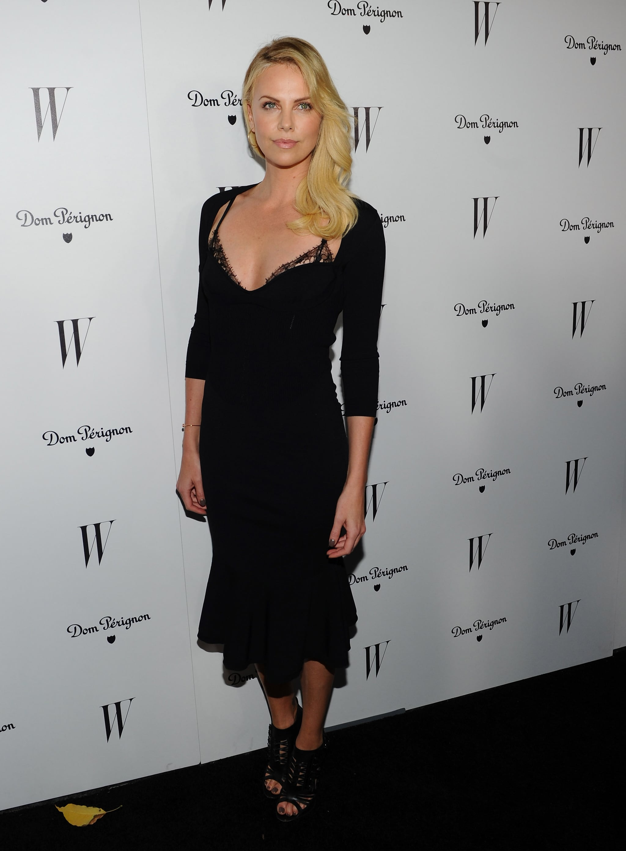 Letting a little lace peek through was the name of the game for Charlize when she wore this slinky black Alexander McQueen dress in early 2012.