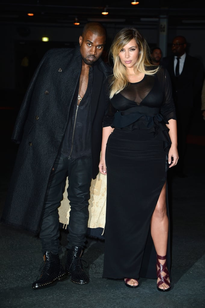 Kanye West and Kim Kardashian coordinated in all-black ensembles at the Givenchy Spring 2014 show.