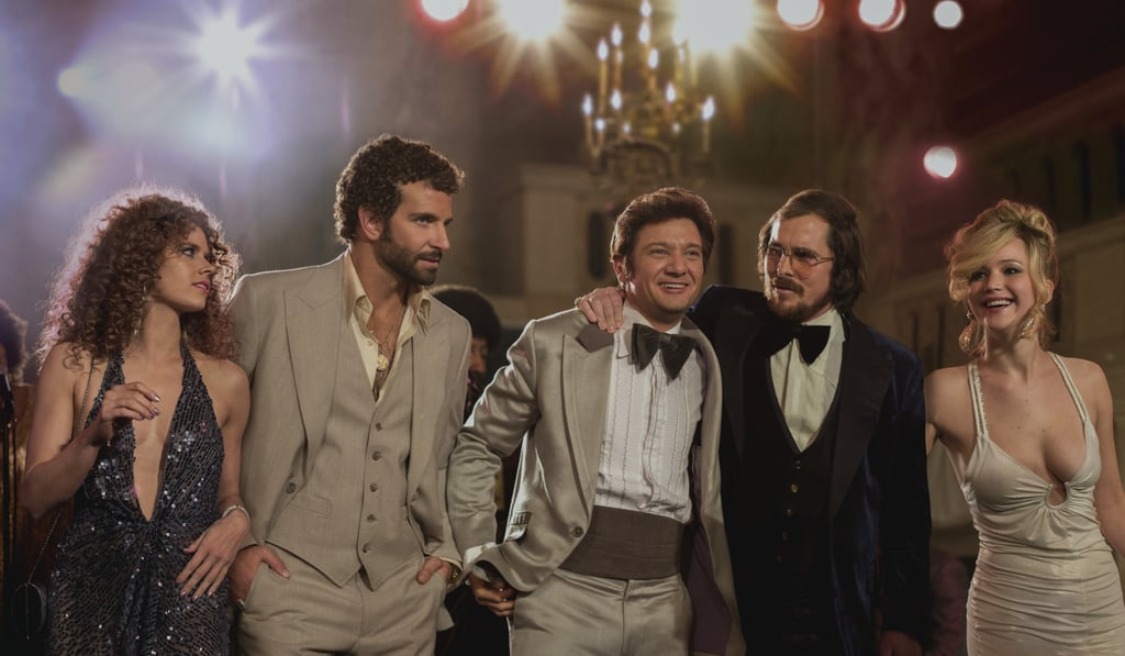 American Hustle  What it's about: Director David O. Russell heads to the 1970s for this crime drama about the sting operation known as ABSCAM. Why we're interested: OK, let's take a minute to appreciate this cast: Amy Adams, Bradley Cooper, Jeremy Renner, Christian Bale, Jennifer Lawrence, Robert De Niro, and Louis C.K. This is going to be epic. When it opens: Dec. 13 Watch the trailer for American Hustle.