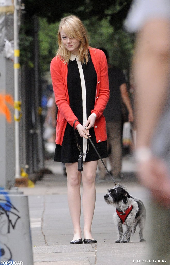 Emma Stone wore a red cardigan over a black dress to bid farewell to her mom after a visit in NYC.