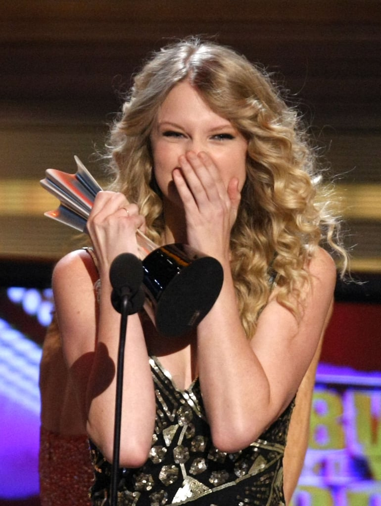 Taylor Swift covered her face while accepting her album of the year award at the Academy of Country Music Awards in April 2009.