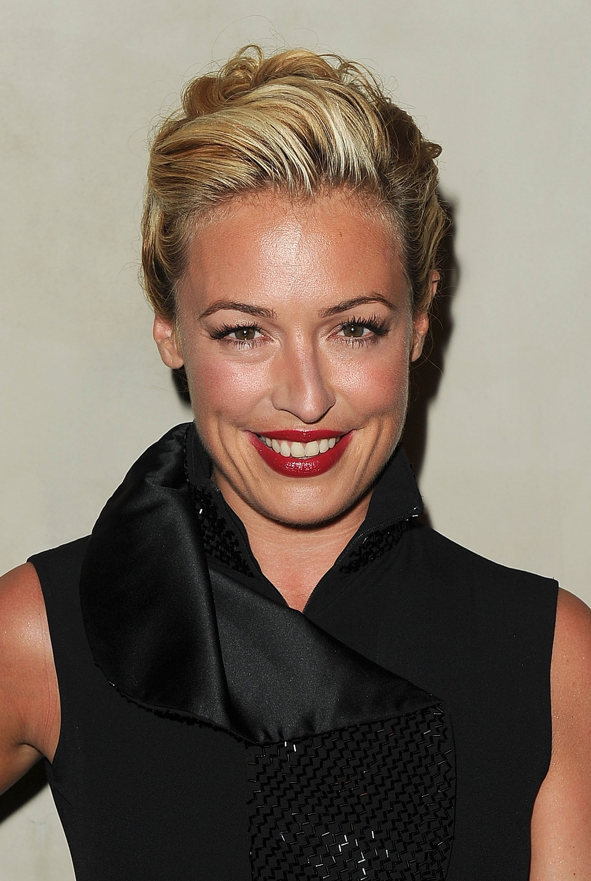 Cat Deeley paused for photographers on her way into a dinner for Armani.