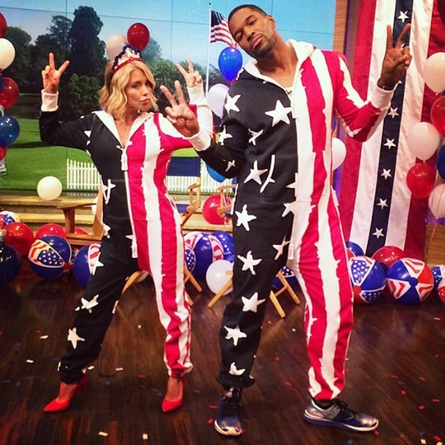 Kelly Ripa and Michael Strahan wore patriotic onesies while filming their morning talk show. Source: Instagram user kellyandmichael