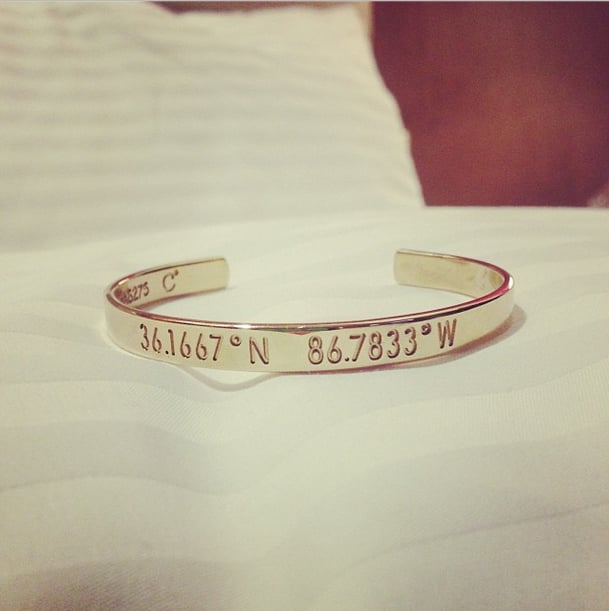 Lucy Hale's bracelet gave the coordinates to Nashville. Source: Instagram user lucyhale