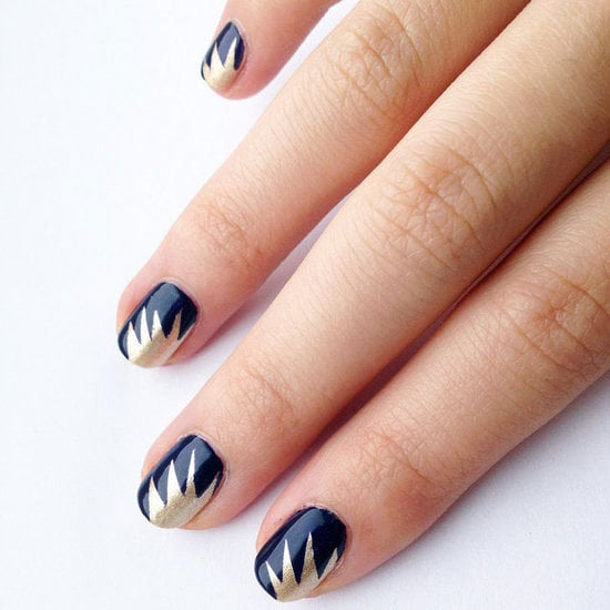 All you need are scissors and tape to create this stunning starburst nail art design.