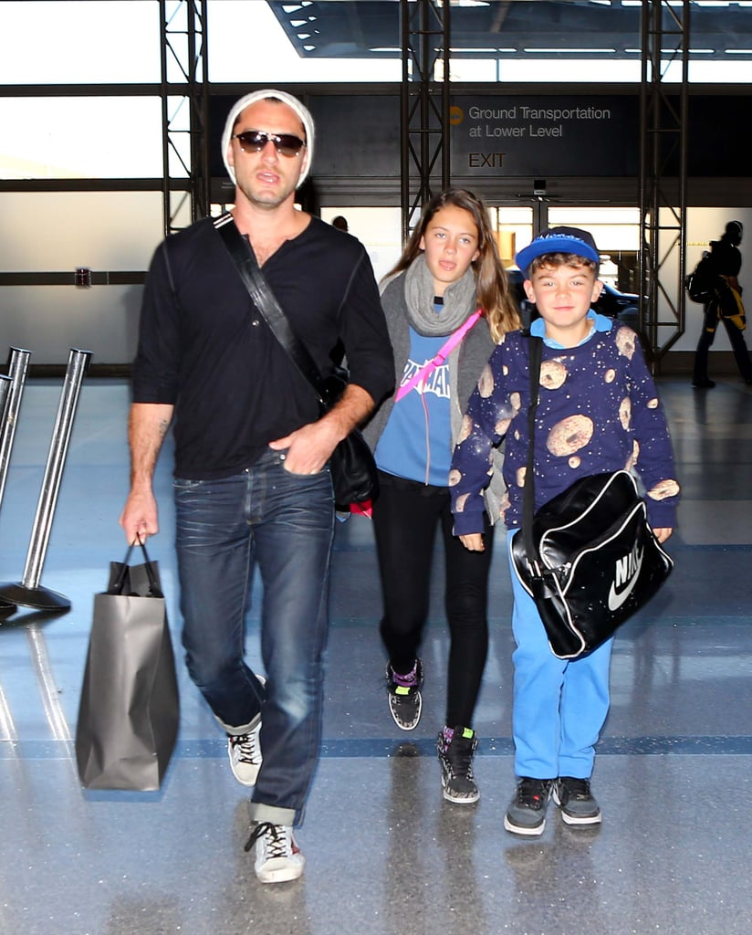 Jude Law wore a white beanie and sunglasses in the airport.