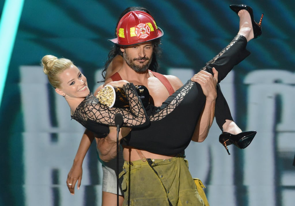 A shirtless Joe swept Elizabeth Banks off her feet at the MTV Movie Awards in June 2013 as he appeared on stage as his Magic Mike character.