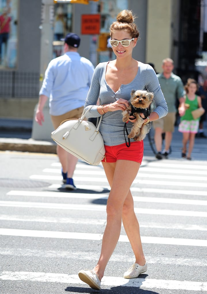 Jessica Hart was practically the picture of Summer in her red shorts,  Carrera sunglasses, and laid-back henley.